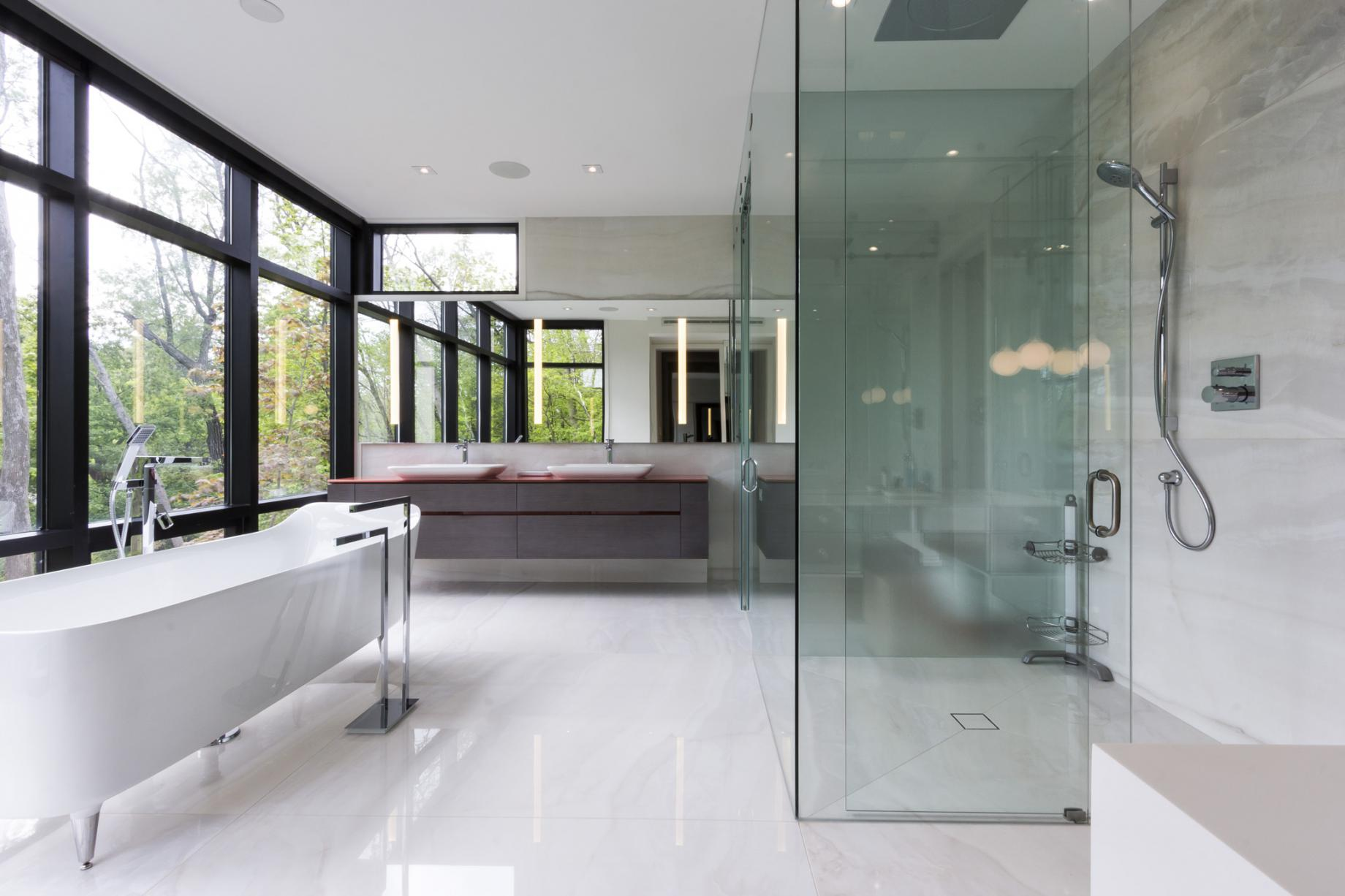 The Glass House master bathroom features remarkable views over the property... and plenty of privacy