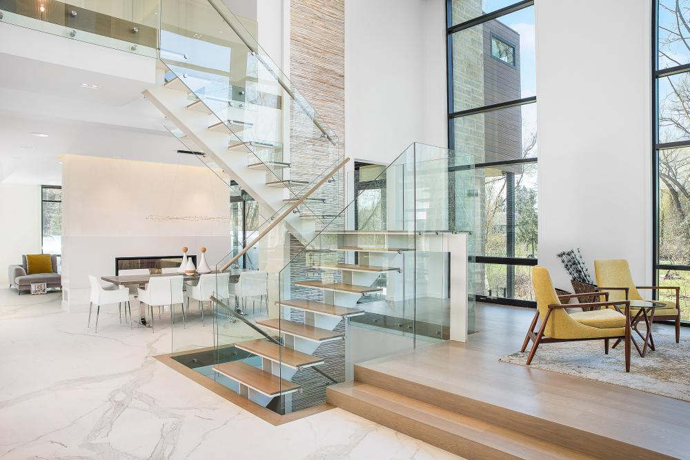 Glass house interior showing glass staircase and bamboo wall