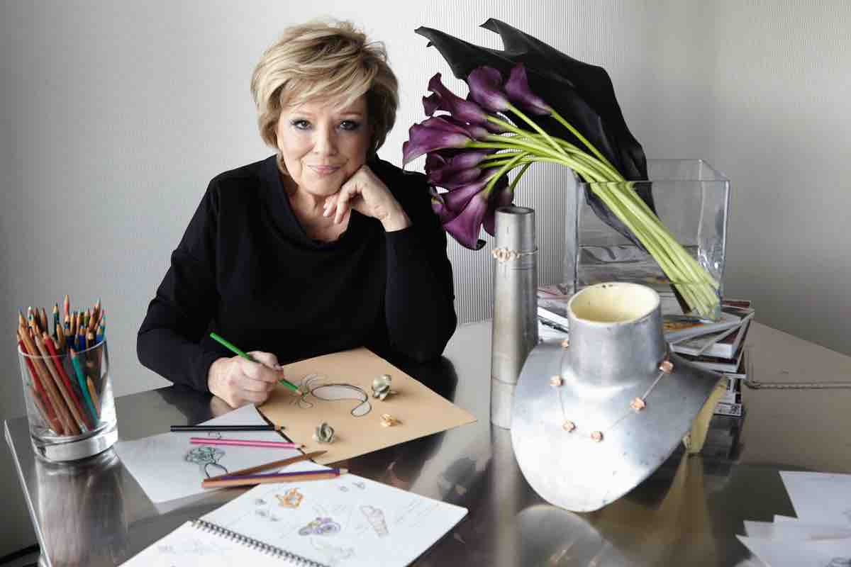 Jewellery Designer Annamaria Cammilli posing with sketches of her work