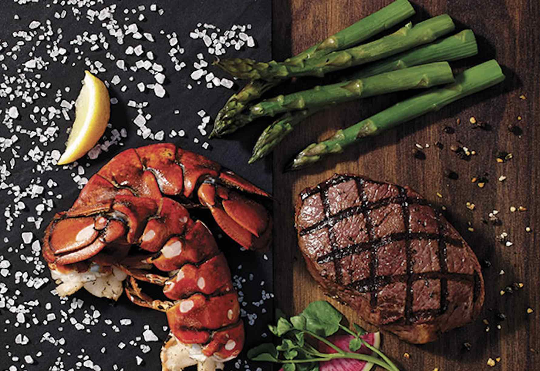 Baton Rouge Steakhouse and Bar seafood and steak on a cutting board