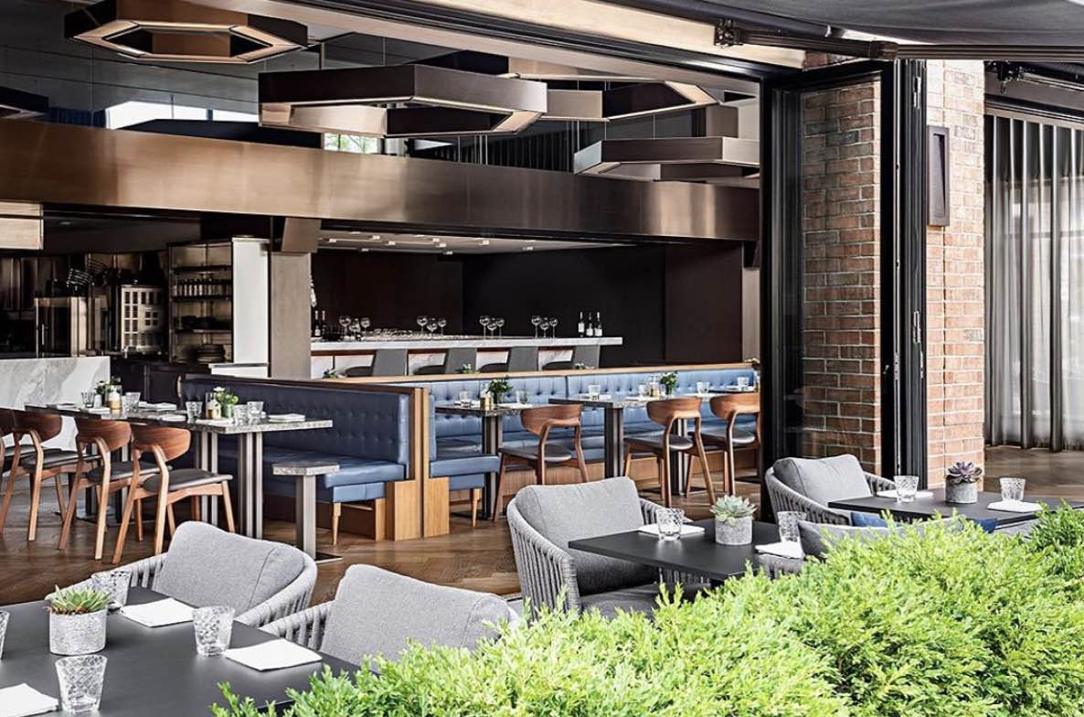 Hexagon Oakville restaurants patio with chairs and tables set
